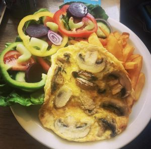 Mushroom Omelette served with Salad and Chips